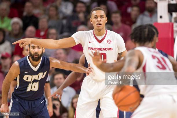 Daniel Gafford of the Arkansas Razorbacks directs the offense during a game against the Oral Roberts Golden Eagles at Bud Walton Arena on December 19...