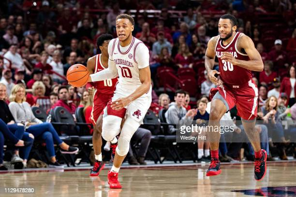 Daniel Gafford of the Arkansas Razorbacks dribbles the ball down the court during a game against the Alabama Crimson Tide at Bud Walton Arena on...