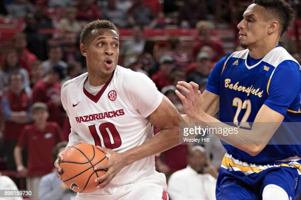 Daniel Gafford of the Arkansas Razorbacks drives to the basket against Moataz Aly of the CSUBakersfield Roadrunners at Bud Walton Arena on December...