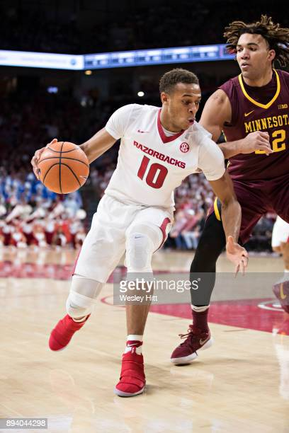 Daniel Gafford of the Arkansas Razorbacks drives to the basket against Reggie Lynch of the Minnesota Golden Gophers at Bud Walton Arena on December 9...