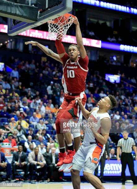 Daniel Gafford of the Arkansas Razorbacks dunks the ball against the Florida Gators during the second round of the SEC Basketball Tournament at...