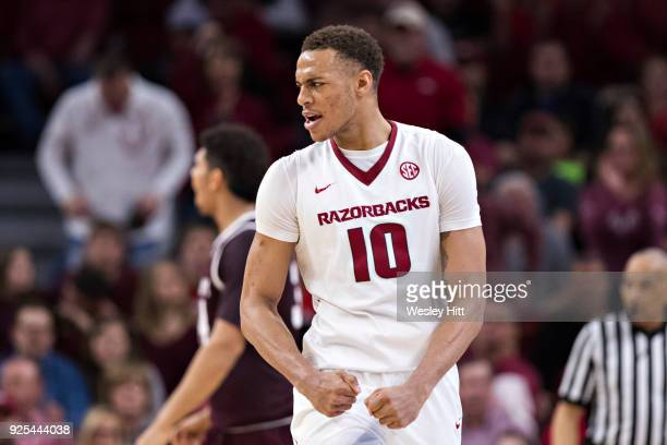 Daniel Gafford of the Arkansas Razorbacks flexes his muscles during a game against the Texas AM Aggies at Bud Walton Arena on February 17 2018 in...