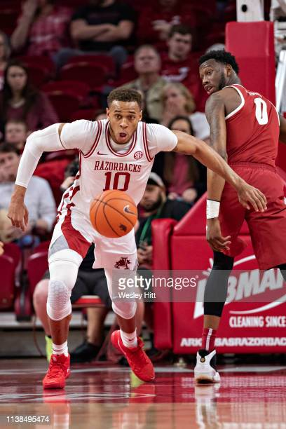 Daniel Gafford of the Arkansas Razorbacks goes after a loose ball during a game against the Alabama Crimson Tide at Bud Walton Arena on March 9 2019...