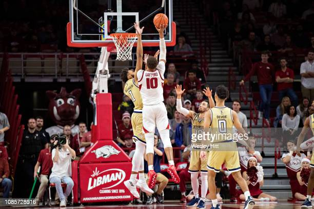 Daniel Gafford of the Arkansas Razorbacks goes up for a shot over James Banks III of the Georgia Tech Yellow Jackets at Bud Walton Arena on December...
