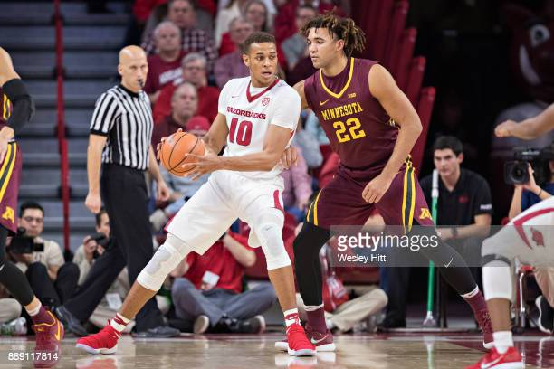 Daniel Gafford of the Arkansas Razorbacks has the ball under the basket against Reggie Lynch of the Minnesota Golden Gophers at Bud Walton Arena on...