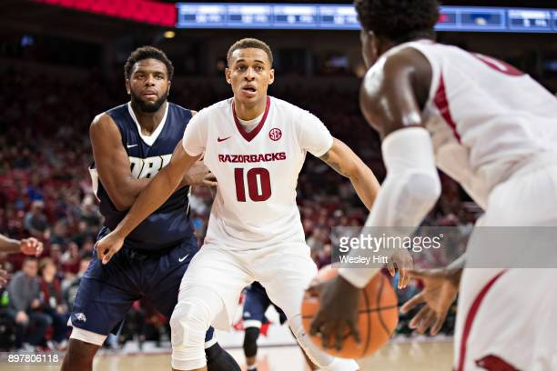 Daniel Gafford of the Arkansas Razorbacks looks for a pass during a game against the Oral Roberts Golden Eagles at Bud Walton Arena on December 19...