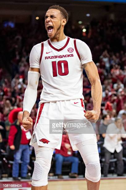 Daniel Gafford of the Arkansas Razorbacks reacts after dunking the basketball during a game against the LSU Tigers at Bud Walton Arena on January 12,...