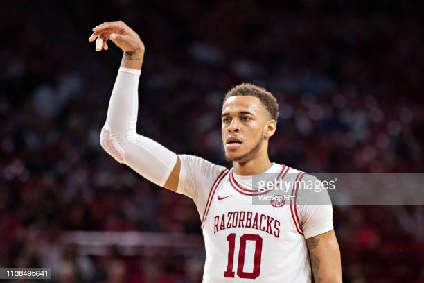 Daniel Gafford of the Arkansas Razorbacks reacts after hitting a jump shot during a game against the Alabama Crimson Tide at Bud Walton Arena on...