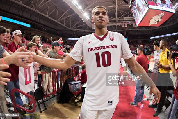 Daniel Gafford of the Arkansas Razorbacks slaps hands with fans after a game against the Fresno State Bulldogs at Bud Walton Arena on November 17,...
