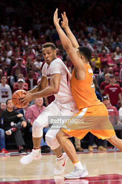 Daniel Gafford of the Arkansas Razorbacks tries to drive to the basket against Grant Williams of the Tennessee Volunteers at Bud Walton Arena on...