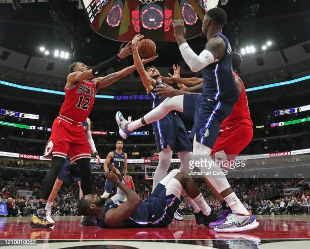 Daniel Gafford of the Chicago Bulls battles for a rebound with Maxi Kleber and Dorian Finney-Smith of the Dallas Mavericks over a fallen Tim Hardaway...