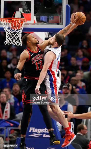 Daniel Gafford of the Chicago Bulls blocks a dunk attempt by Sviatoslav Mykhailiuk of the Detroit Pistons during the first half at Little Caesars...