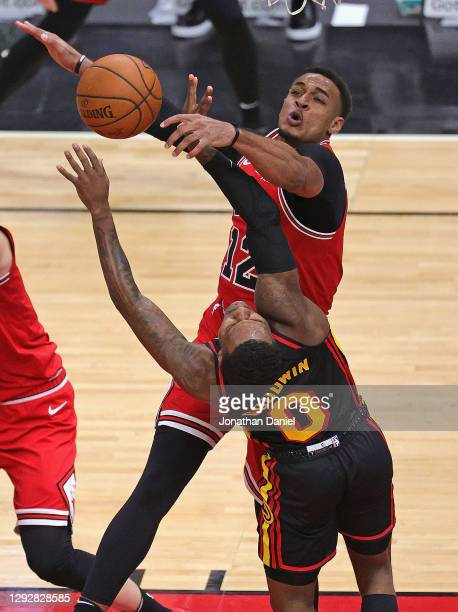 Daniel Gafford of the Chicago Bulls blocks a shot by Brandon Goodwin of the Atlanta Hawks at United Center on December 23, 2020 in Chicago, Illinois....