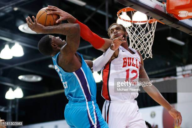 Daniel Gafford of the Chicago Bulls blocks a shot by Dwayne Bacon of the Charlotte Hornets during the 2019 Summer League at the Cox Pavilion on July...
