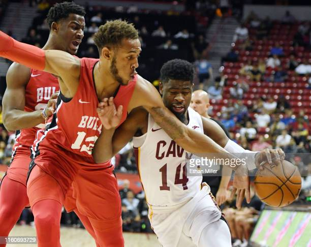 Daniel Gafford of the Chicago Bulls knocks the ball away from Malik Newman of the Cleveland Cavaliers during the 2019 NBA Summer League at the Thomas...