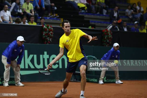 Daniel Galan from Colombia in action against Juan Ignacio Londero from Argentina in the individual match for the Davis Cup at the Palacio de Los...