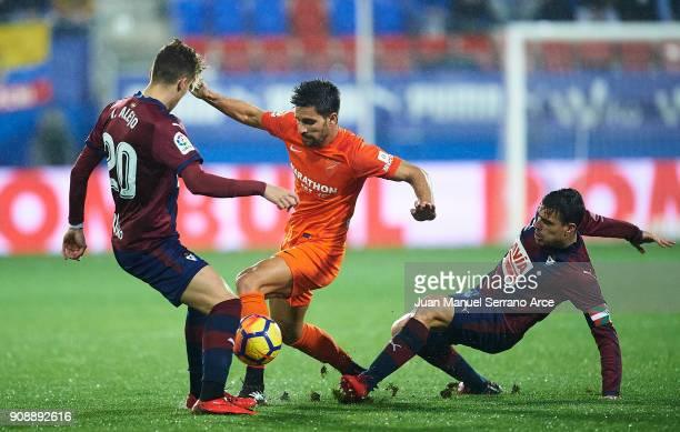 Daniel Garcia of SD Eibar duels for the ball with Adrian Gonzalez of Malaga CF during the La Liga match between SD Eibar and Malaga CF at Ipurua...