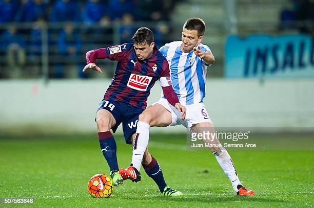 Daniel Garcia of SD Eibar duels for the ball with Ignacio Camacho of Malaga CF during the La Liga match between SD Eibar and Malaga CF at Ipurua...