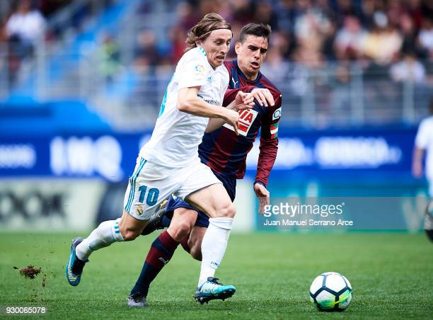 Daniel Garcia of SD Eibar duels for the ball with Luka Modric of Real Madrid during the La Liga match between SD Eibar and Real Madrid at Ipurua...