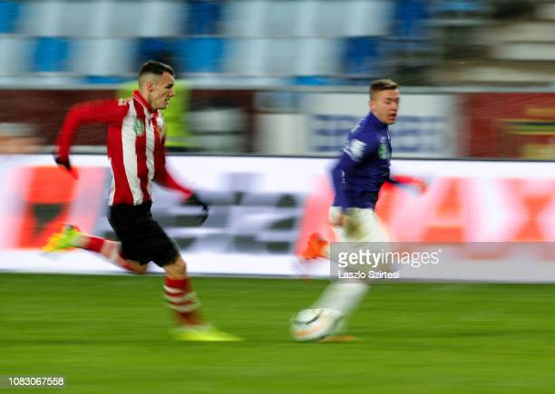 Daniel Gazdag of Budapest Honved competes for the ball with Donat Zsoter of Ujpest FC during the Hungarian OTP Bank Liga match between Budapest...