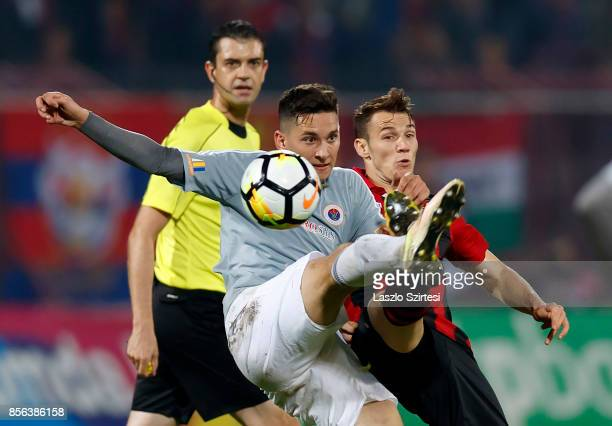 Daniel Gazdag of Budapest Honved competes for the ball with Mate Vida of Vasas FC before referee Viktor Kassai during the Hungarian OTP Bank Liga...