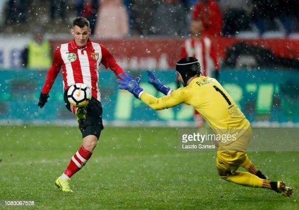Daniel Gazdag of Budapest Honved tries to lob the ball over Filip Pajovic of Ujpest FC during the Hungarian OTP Bank Liga match between Budapest...