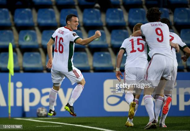 Daniel Gazdag of Hungary celebrates with teammates after scoring their team's second goal during the FIFA World Cup 2022 Qatar qualifying match...