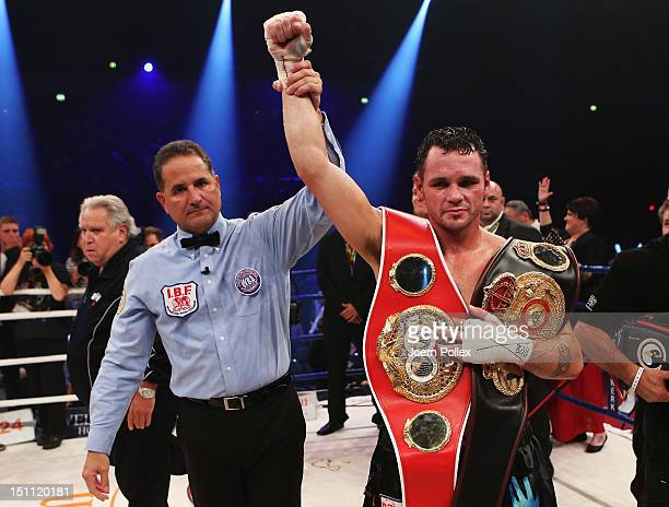 Daniel Geale of Australia celebrates after winning his WBA and IBF middleweight world championship fight against Felix Sturm of Germany at Arena on...