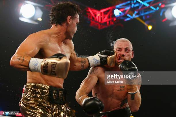 Daniel Geale punches Garth Wood during the IBF Middleweight Pan Pacific title bout between Garth Wood of Australia and Daniel Geale of Australia at...