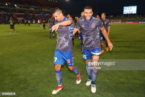 Daniel Georgievski and Andrew Nabbout of the Jets celebrate the win over Sydney FC during the round 22 ALeague match between the Newcastle Jets and...