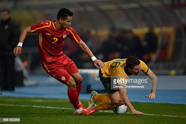 Daniel Georgievski of Macedonia challenges Nathan Burns of Australia during the International Friendly match between Macedonia and Australia on March...