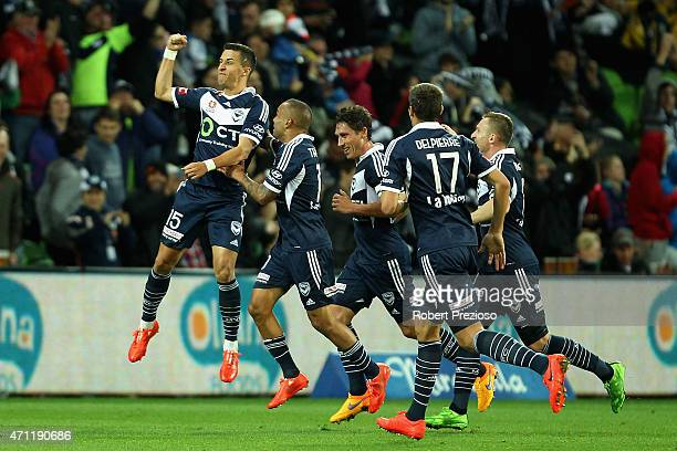 Daniel Georgievski of Melbourne celebrates with teammates after scoring a goal during the round 27 ALeague match between the Melbourne Victory and...