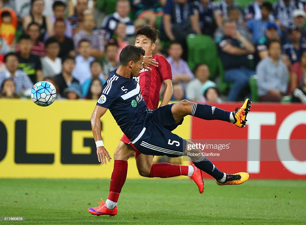 Daniel Georgievski of Melbourne Victory is challenged by Lei Wu of Shanghai SIPG during the AFC Asian Champions League match between Melbourne Victory and Shanghai Sipg at AAMI Park on February 24, 2016 in Melbourne, Australia.