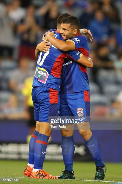 Daniel Georgievski of the jets celebrates with team mate Andrew Nabbout celebrates a goal during the round eight ALeague match between the Newcastle...