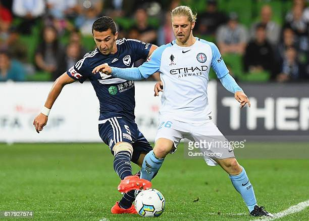 Daniel Georgievski of the Victory and Luke Brattan of the City compete for the ball during the FFA Cup Semi Final match between Melbourne City FC and...