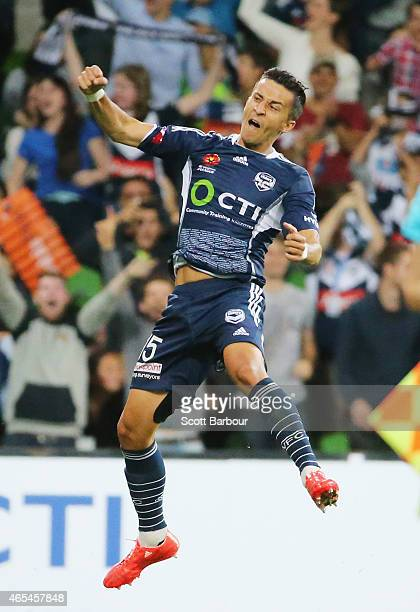 Daniel Georgievski of the Victory celebrates after scoring the Victorys first goal during the round 20 ALeague match between Melbourne Victory and...
