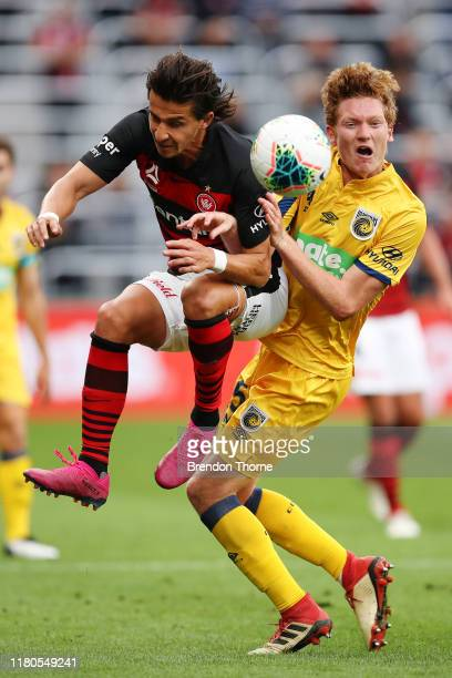 Daniel Georgievski of the Wanderers competes with Kye Rowles of the Mariners during the round one ALeague match between the Western Sydney Wanderers...