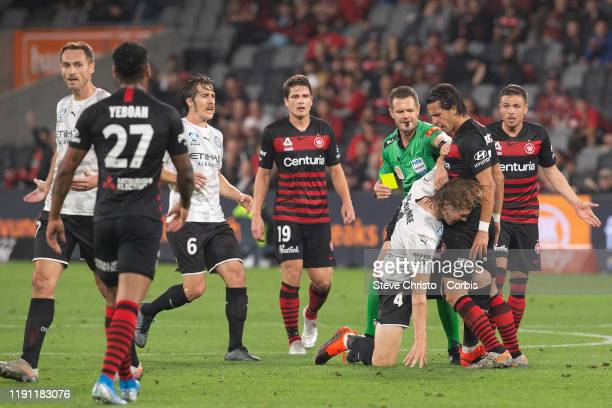 Daniel Georgievski of the Wanderers is tackled by Harrison Delbridge of Melbourne City FC during the round 7 A-League match between the Western...