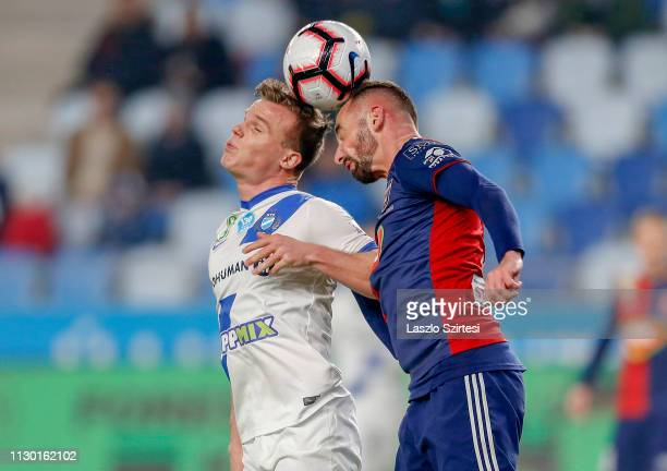 Daniel Gera of MTK Budapest battles for the ball in the air with Attila Fiola of MOL Vidi FC during the Hungarian OTP Bank Liga match between MTK...
