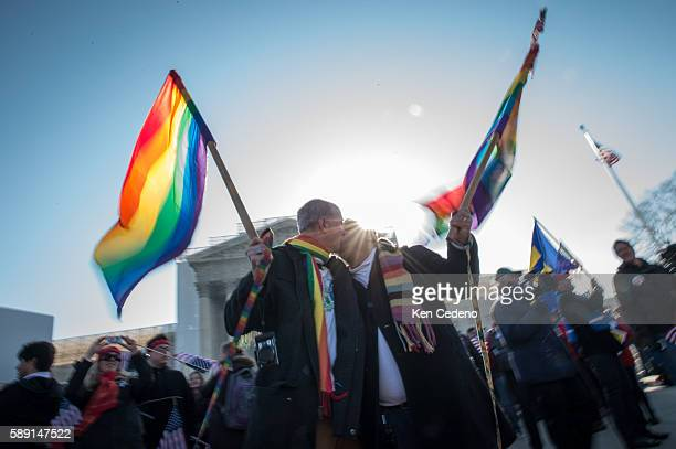 Daniel German Domigez and his partner Marcos German Domigez kiss while marriage equality supporters rally at the US Supreme Court while arguments on...