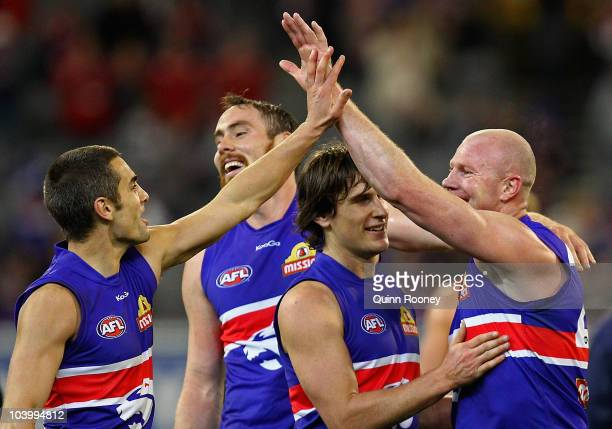 Daniel Giansiracusa Ben Hudson Ryan Griffen and Barry Hall of the Bulldogs celebrate winning the AFL First Semi Final match between the Western...