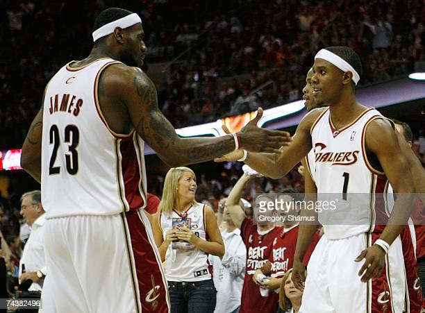 Daniel Gibson and LeBron James of the Cleveland Cavaliers react after Gibson was fouled as he missed a 3point field goal attempt against the Detroit...