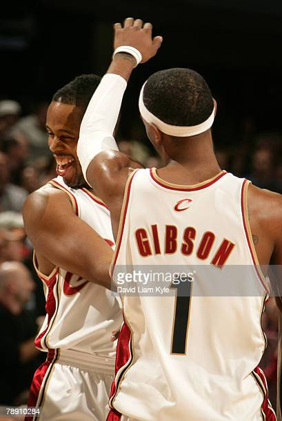 Daniel Gibson of the Cleveland Cavaliers congratulates teammate Damon Jones after he sinks a three to put their team up by 7 in the second overtime...