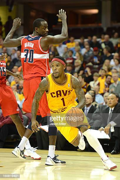 Daniel Gibson of the Cleveland Cavaliers drives past Earl Barron of the Washington Wizards during the game against the Washington Wizards at Quicken...