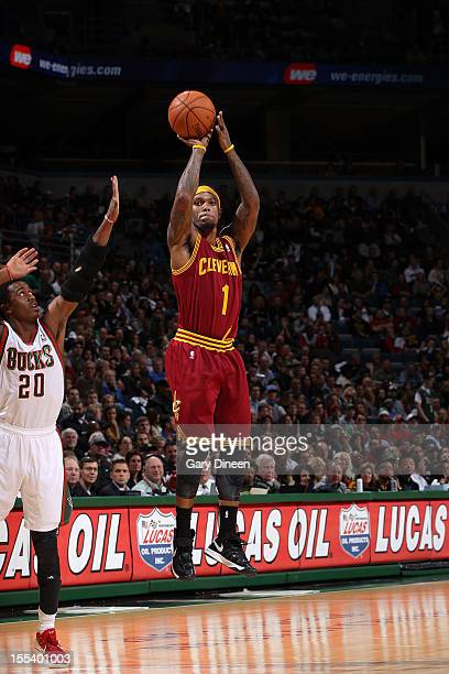 Daniel Gibson of the Cleveland Cavaliers shoots against Doron Lamb of the Milwaukee Bucks during the NBA game on November 3 2012 at the BMO Harris...