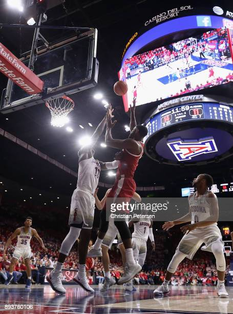 Daniel Giddens of the Alabama Crimson Tide attempts a shot over Deandre Ayton of the Arizona Wildcats during the first half of the college basketball...