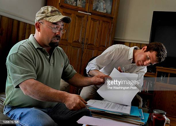 Daniel Gilbert right goes over some documentation with Jamie Hale who was one of the subjects for the Pulitzer Prize winning series that Gilbert...