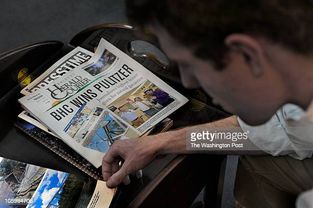 Daniel Gilbert thumbs through a magazine in a waiting area while waiting to meet his publisher Carl Esposito The front page of the newspaper touting...