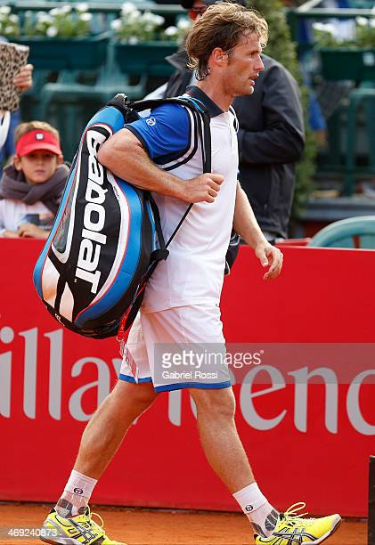 Daniel Gimeno Traver of Spain leaves the field after being defeated during a tennis match between Nicolas Almagro and Daniel Gimeno Traver as part of...