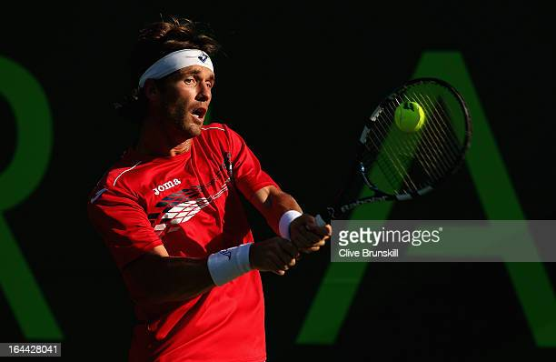 Daniel GimenoTraver of Spain plays a backhand against Tomas Berdych of Czech Republic during their second round match at the Sony Open at Crandon...